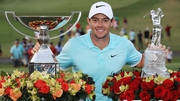 Rory McIlroy poses with the FedExCup and TOUR Championship trophies