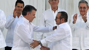 Colombian President Juan Manuel Santos and FARC leader Timochenko shake hands at last week's accord before it was defeated at the polls