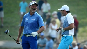 Darren Clarke and Rory McIlroy share a joke at the PGA Championship in August