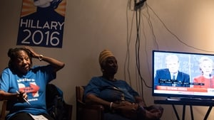 Women watch the debate at the South Carolina Hillary Clinton campaign headquarters