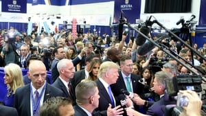 Donald Trump speaks to the media in the spin room