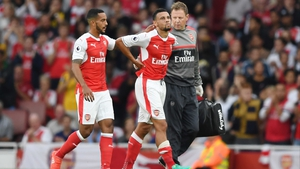 Francis Coquelin (C) leaves the field injured at the weekend