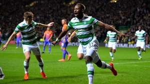 Moussa Dembele celebrates his opener at Celtic Park