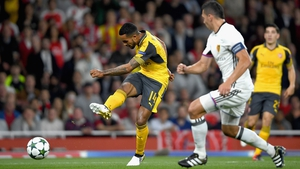 Theo Walcott scores his and Arsenal's second goal at the Emirates