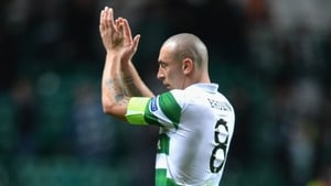 Celtic midfielder Scott Brown applauds the home suppport