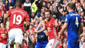 Manchester United's Spanish midfielder Juan Mata (C) celebrates after scoring against Leicester City
