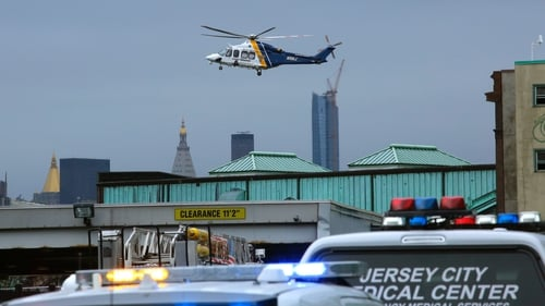 Helicopter flies over New Jersey Transit's railway station