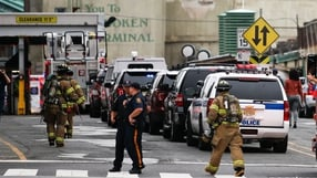 New Jersey police officers and firefighters arrive at the train terminal