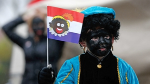 A child dressed as 'Zwarte Piet' walks in Gouda, The Netherlands