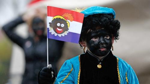 A child dressed as 'Zwarte Piet' walks in Gouda, The Netherlands