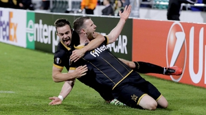 Ciaran Kilduff (R) celebrates with Robbie Benson after scoring against Maccabi Tel Aviv