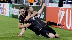 Ciaran Kilduff (R) celebrates with Robbie Benson after scoring against Maccabi Tel Aviv