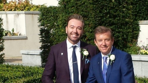 "Hughes says he is ""happy and proud"" to have wed his long-term partner Karl Broderick"