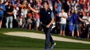 McIlroy celebrates his eagle putt to win his four-ball match