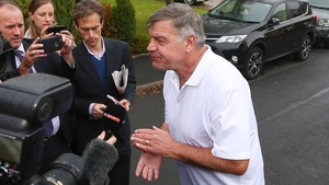 Sam Allardyce talks to reporters outside his house in Bolton following his sacking