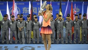 Petra Kvitova poses with the trophy at Optics Valley International Tennis Center