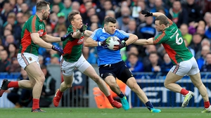Kevin McManamon of Dublin is surrounded by Mayo men