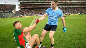 Dublin's Philip McMahon with Aidan O'Shea of Mayo after the game