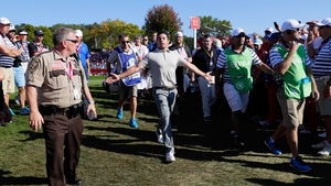 Rory McIlroy reacts following abuse on the way to the 12th