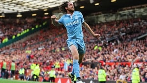 Joe Allen leaps into the air in delight after his equaliser