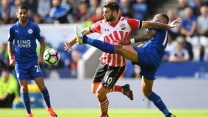 Southampton's Charlie Austin is tackled by Danny Simpson