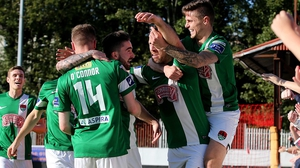 Cork City players mob Alan Bennett after his goal against St Pat's