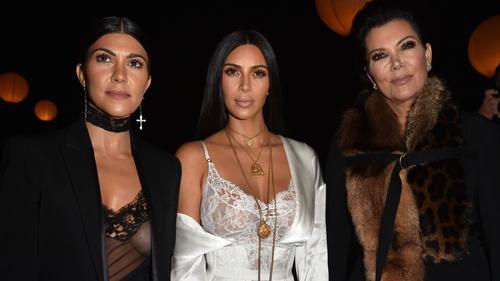 Kourtney and Kim Kardashian with their mother Kris Jenner