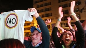 No supporters celebrate following their victory in the referendum in Bogota