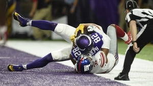 Kyle Rudolph (82) touches down for the Vikings