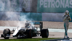 Lewis Hamilton walks away from his car during the Malaysian Grand Prix