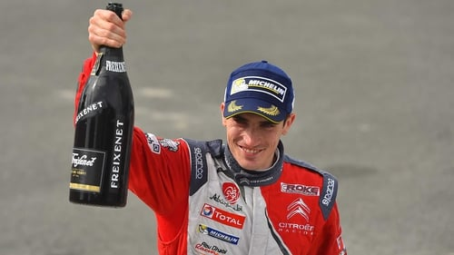 Craig Breen celebrates third place in Finland