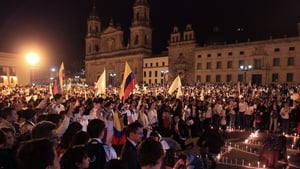 Colombians take part in a 'March for Peace' in Bogota yesterday
