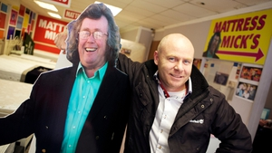 Paul Kelly (right) with a cardboard cutout of his creation