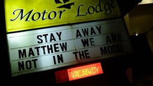 A motel displays a sign asking Hurricane Matthew to stay away in Kill Devil Hills in North Carolina as the storm makes its way towards the US