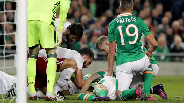 Robbie Brady down after the clash of heads