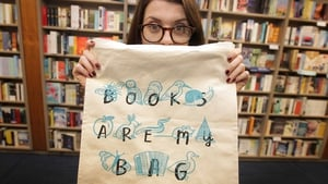 Illustrator Kathi 'Fatti' Burke with her tote bag celebrating Irish books and bookshops.