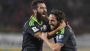 Joe Allen (R) celebrates his goal against Austria