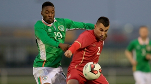 Olamide Shodipo with Milan Gajic of Serbia during their Under-21 clash in Waterford