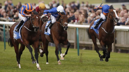 Ryan Moore and Churchill (L) pass the challengers for victory