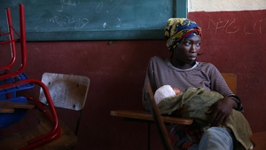 A woman with her baby remains in the shelter of the Lyceum Jean Claudy Muzo , in Les Cayes