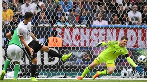 Michael McGovern (R) saves from Mario Gomez (L) during the summer Euros
