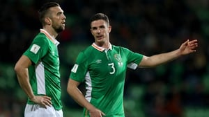 Ireland centre halves Shane Duffy and Ciaran Clark talk during the away in over Moldova