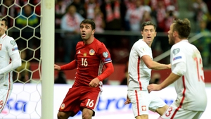 Poland's forward Robert Lewandowski scores the winner