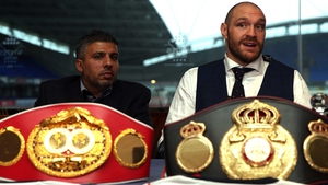 Tyson Fury (R) said: 'I have taken the hard and emotional decision to now officially vacate my treasured world titles.'