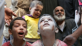 Syrian boys cry following Russian air strikes on the  Fardous neighbourhood of the northern embattled Syrian city of Aleppo
