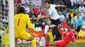 Mesut Ozil skips past Ashley Cole during Germany's clash with England at the 2010 World Cup