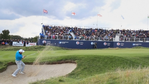 Graeme McDowell plays from a bunker on the 18th