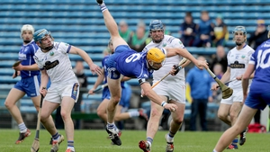 Sarsfields' Padraic Maher takes a tumble while claiming posession