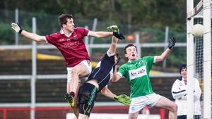 Shane McGuigan (L) finds the net for Slaughtneil