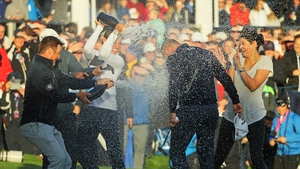 Alex Noren is soaked in champagne on the 18th green